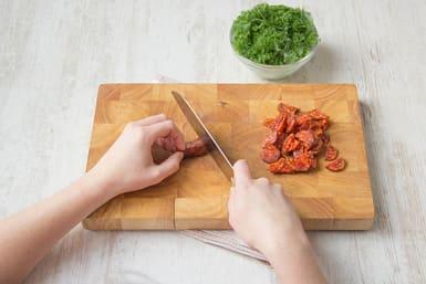 Chop kale, chorizo, parsley and garlic