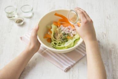 Toss cucumber and carrot salad