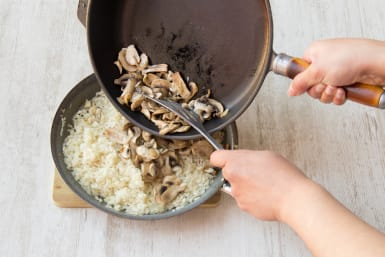 Add the mushrooms to the risotto