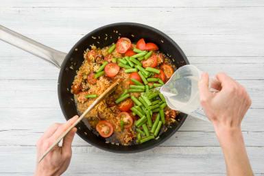 Add the veggies, stock, & water