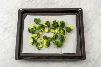 Cook the rice and roast the broccoli