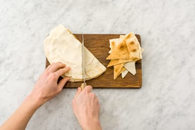 Cut the Lebanese bread into triangles