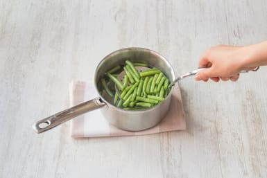 Cook the green beans and potatoes