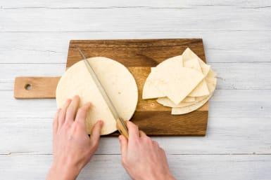 Cut the tortillas into triangles