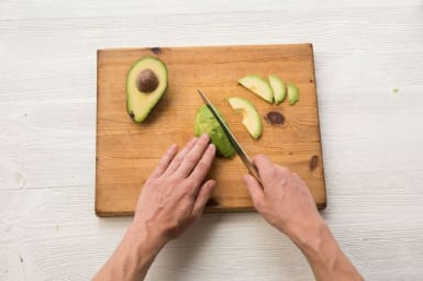 Halve, pit, and thinly slice the avocado