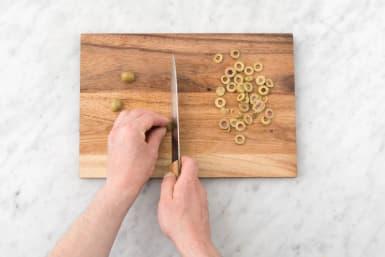Slice the green olives
