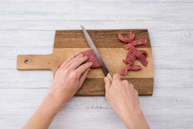 Cut the steak into thin ribbons