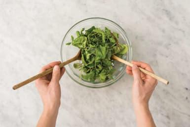 Dress the salad leaves