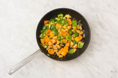 Cook Peppers and Pineapple