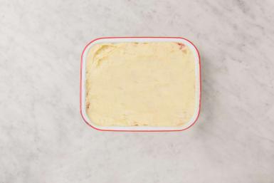 Täck med potatismos