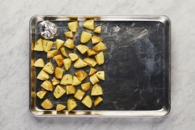 Toss Potatoes & Garlic
