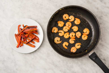 Cook peppers and shrimp