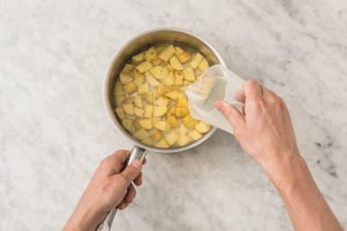 Cook potatoes and start prep