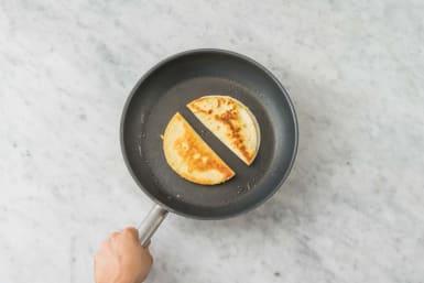 Cook quesadillas