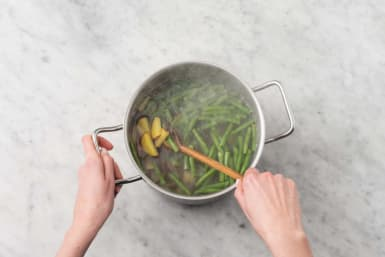 Cook potatoes and green beans
