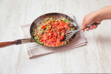 Stir in crushed tomatoes