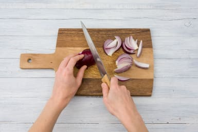 Cut the red onion into wedges