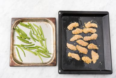Bake the green beans and chicken strips