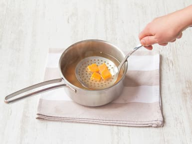Boil sweet potato.