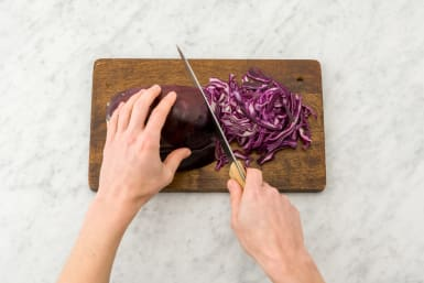 Finely slice the red cabbage