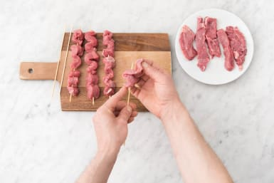 Weave the beef strips onto the skewers