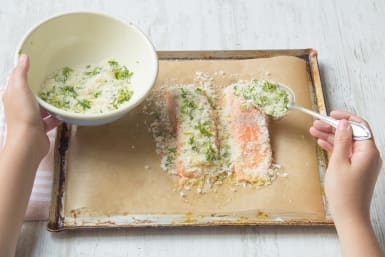 Spoon the crumb mixture onto the top side of the salmon