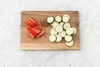 Preheat oven and prep veggies
