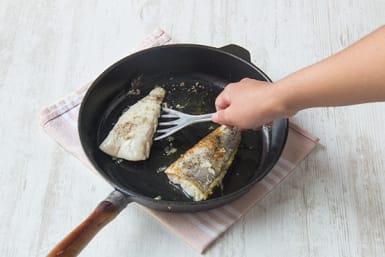 Cook fish.