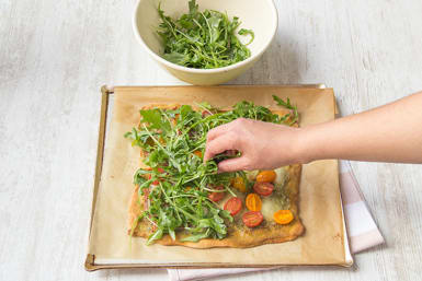 Top with arugula salad