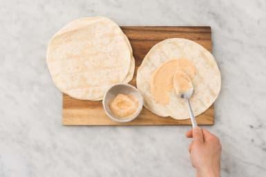 Spread mayo between tortillas