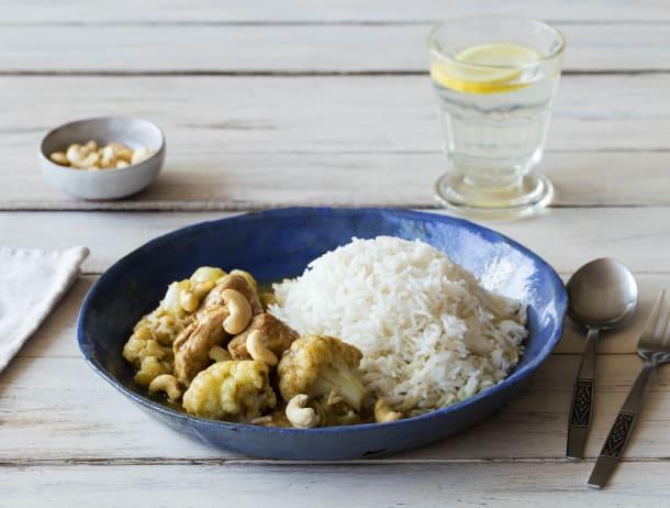 Groene curry met varkenshaasblokjes en cashewnoten