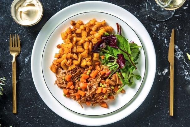 Kalfsstoofvlees met wortel en doperwten
